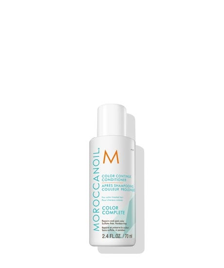 Meet the NEW Moroccanoil Color Complete Collection, our revolutionary 360approach to color care that starts in the salon and is maintained at home. The collection helps your haircolor last longer between appointments, preserving the sense of confidence you gain from salon-fresh color. Nourishing and sulfate-free, Color Continue Conditioner helps extend the results of the in-salon ChromaTech Service by restoring hair's integrity. The key to this process is COLORLINK technology, which repairs and nourishes each strand on both a physical and chemical level in three ways: 1. Rebuilds the keratin structure to restore hair fiber and lock color within 2. Forms a protective shield that minimizes color washout 3. Uses ArganID technology, an ionic delivery system that both seals and repairs the hair and infuses argan oil into the cortex To enjoy the full benefits of the Color Complete Collection, start in the salon with the professional ChromaTech Service. After 10 washes, the collection is sci