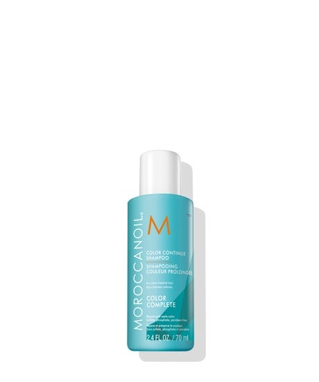 Meet the NEW Moroccanoil Color Complete Collection, our revolutionary 360 approach to color care that starts in the salon and is maintained at home. The collection helps your haircolor last longer between appointments, preserving the sense of confidence you gain from salon-fresh color. Designed to extend the results of the in-salon ChromaTech Service, Color Continue Shampoo helps improve color retention by restoring hair health-leaving your hair shinier, glossier and with more vibrant color, depth, and dimension. This gentle, sulfate-free cleanser is formulated with COLORLINK, our groundbreaking technology that repairs and nourishes each strand both physically and chemically in three crucial ways: 1. Rebuilds the keratin structure to restore hair fiber and lock color within 2. Forms a protective shield that minimizes color washout 3. Uses ArganID technology, an ionic delivery system that both seals and repairs the hair and infuses argan oil into the cortex To enjoy the full benefits o
