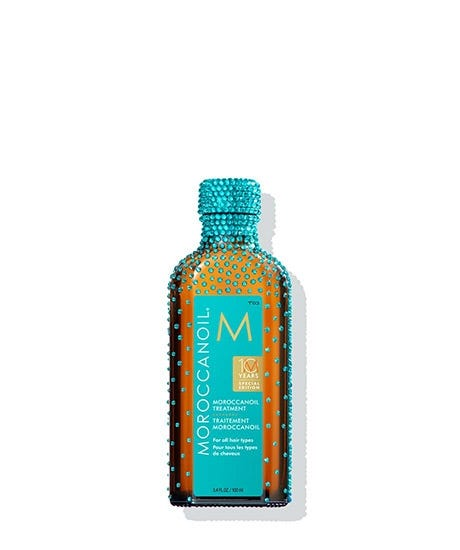 DISCOVER THE ORIGINAL In honor of our first decade of oil-infused innovation, this partnership with Swarovski reimagines the iconic Moroccanoil Treatment as a glass bottle elegantly adorned with luxurious crystals. The handmade bottle features nearly a thousand of the finest Swarovski crystals, trickling from the cap and bottle neck down to the body of the bottle in our signature Moroccanoil Blue. Get the silky, shiny and healthy hair you've always wanted. Moroccanoil Treatment is the product that pioneered oil-infused hair care and created the worldwide buzz on argan oil. The original foundation for hairstyling, Moroccanoil Treatment can be used as a conditioning, styling and finishing tool. Infused with antioxidant-rich argan oil and shine-boosting vitamins, this completely transformative hair treatment detangles, speeds up drying time and boosts shine-leaving you with nourished, manageable and smooth hair with each use. Outshine the rest.