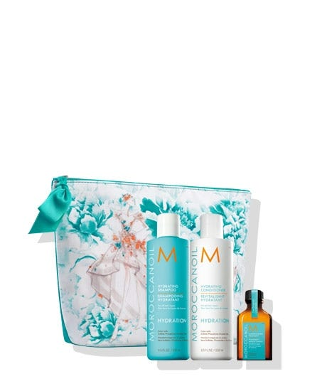 Start spring in style with hydrating essentials in a free, custom-designed cosmetic bag by renowned fashion brand Marchesa. This limited edition set includes Hydrating Shampoo and Conditioner to enhance hair's manageability, as well as a free Moroccanoil Treatment to provide argan oil-infused conditioning. This collaboration will benefit The Magic Bus Foundation, a non-profit that aims to lift communities in India out of poverty and into livelihood. Hydrating Shampoo (8.5 FL. OZ. / 250 ml) a gentle, daily-use shampoo that instantly infuses all hair types with hydration. Hydrating Conditioner (8.5 FL. OZ. / 250 ml) a nourishing, daily-use conditioner offering optimal hydration for all hair types. FREE Moroccanoil Treatment (0.85 FL. OZ. / 25 ml) is an argan oil-infused conditioning, styling and finishing tool that sets the perfect foundation for hairstyling.