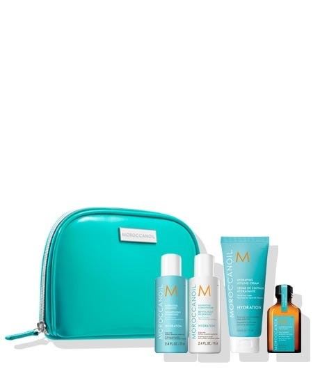 Quench thirsty hair on the go with the Moroccanoil Destination: Hydrate Travel Set. Featuring Hydrating Shampoo and Conditioner, the original Moroccanoil Treatment and Hydrating Styling Cream, this limited edition set helps keep normal to dry hair deeply hydrated and perfectly styled. The argan oil-infused products come in a free cosmetic bag, perfect for a trip to the gym or a weekend away. Hydrating Shampoo (2.4 FL. OZ. / 70 ml) a gentle, daily-cleansing formula that provides hair with optimal hydration, leaving hair with increased health, elasticity and vibrance. Hydrating Conditioner (2.4 FL. OZ. / 70 ml) a gentle, daily-use formula that leaves hair soft, shiny and more manageable. Moroccanoil Treatment (0.85 FL. OZ. / 25 ml) the original foundation for hairstyling that can be used as a conditioning, styling and finishing tool. Rich in argan oil and reparative proteins. Hydrating Styling Cream (2.53 FL. OZ. / 75 ml) moisture-rich, argan oil-infused hair styling cream adds shine an